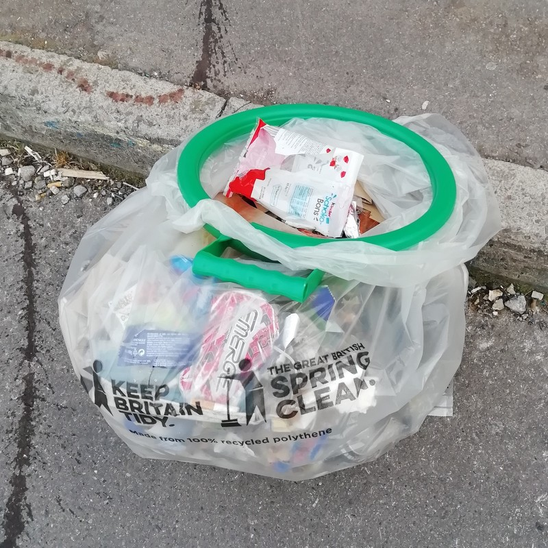 A plastic bag filled with rubbish