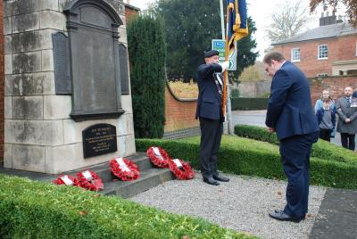 Town-Mayor Councillor Mark Cooper pays his respects